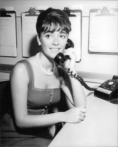 Vintage photo of Anna Maria Alberghetti smiling on phone call. -