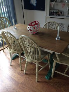 Up cycled dining table and 5 chairs (one left to do!) Table legs in French green chalk paint (homemade) and chairs in antique white, distressed and finished in dark oak wax. Table top sanded and finished in dark oak wax and 3 coats clear Matt varnish