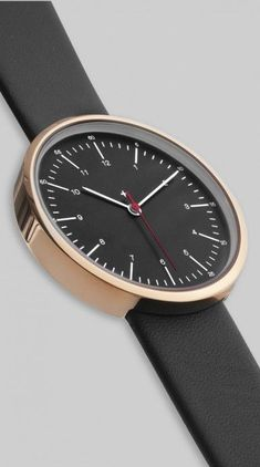 Golden Hour this watch would help you keep track of time in style. Black and gold minimal watch.