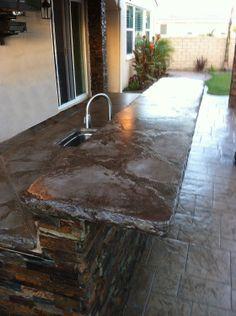 outdoor kitchen; Concrete countertop; stonework