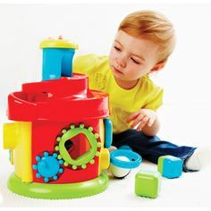 Twist & Turn Activity House - Your toddler will delight in hammering a ball down the chimney and watching it roll down the spiral and clunk into the house.