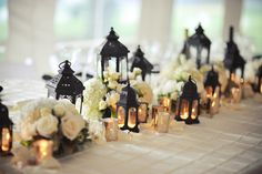 Mix in tall pillar candles and larger candlehosts. Classic and elegant wedding centerpiece idea - black lanterns, silver mercury glass votives, and ivory rose and white hydrangea flower arrangements {Meredith Rogers Photography} Lantern Centerpiece Wedding, Wedding Lanterns, Wedding Centerpieces, Wedding Decorations, Gold Wedding Theme, Our Wedding, Wedding Band, Wedding Ideas, Wedding Shit