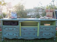 Convert an old dresser into a TV stand by taking out the top drawers for DVD player, etc.  I love this idea!