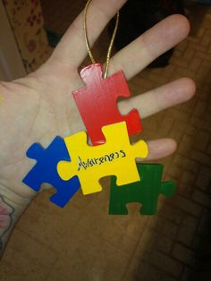 Ornament made of wooden puzzle pieces which had some missing, paint, mod pog and sharpie/ paint pen... autism awareness!! So simple fun and meaningful!
