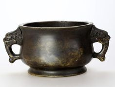BRONZE CENSER WITH STYLIZED DRAGON HANDLE China. Qing Dynasty style,the round bulbous form with two Dragon -head handles at either side, the base marked with Da Ming Xuan De Nian Zhi.