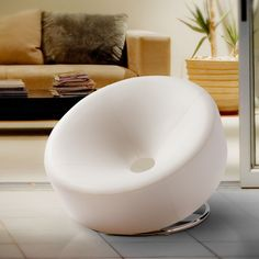 If you are looking for a one-of-a-kind piece of furniture for a contemporary home, this white modern accent chair will quickly become the focal point of any room. Its futuristic, round shape and steel frame accentuate the bonded leather perfectly.