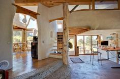 Amazing light and open strawbale house with cob wall interior.