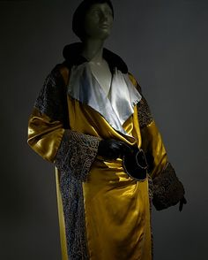 1912 Bright yellow silk Opera coat trimmed with metallic thread. By Paul Poiret.