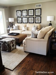 Beige leather sofas, brown leather ottoman, accent poufs with pattern.