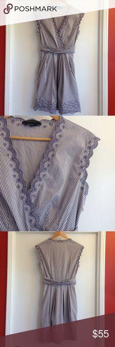 "BCBGMAXAZRIA blue & white stripped dress BCBGMAXAZRIA blue & white stripped dress. Size 6. Floral cutout on trim, v-neckline, sleeveless, side zipper, fabric on waist, lined. Material: 68% cotton, 28% nylon, 4% spandex. Measurements: shoulders: 17.5"", bust: 15.5"", waist: 13"", length: 37"". Pre-loved, no flaws seen. BCBGMaxAzria Dresses Midi"