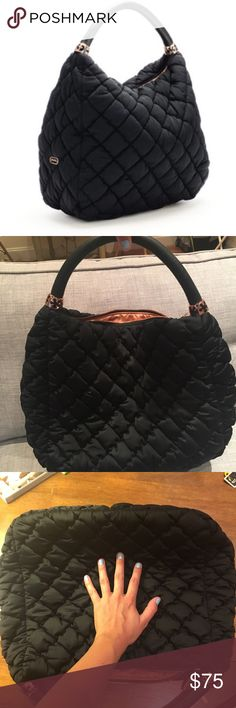 """Folli Follie Black Hobo Bag NWOT. Never used. Has a very comfortable shoulder strap. 14 3/5"""" W x 12 2/5"""" H x 6 1/2"""" D. Polyurethane: Gently rub with a cloth dampened in mild soap or use domestic dry cleaning spray. Fabric: Dry clean with special spray for fabric care. This classic black hobo from Folli Follie's Happy Nugget Collection is all you need for chic accessorizing. Seen here in quilted nylon with leather-like polyurethane straps and enamel floral pattern detailing, it's light in…"""