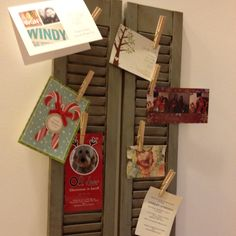 Antiqued old shutters used to display cards and invitations