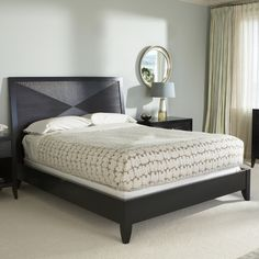 Camden Low Profile Bed Set $1241.99  Elegant, contemporary design with crafted, artisan feel  Constructed of solid mahogany and mahogany veneers  Deep, long-lasting espresso finish  Box spring required; includes wood rails and slat system  Assembled with easy-to-use cam lock system