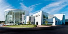Paul Miller BMW, Wayne, NJ - New 75,000 sq. ft. Paul Miller BMW Dealership in Wayne, NJ including a 21,000 sq. ft. Service Center with 44 lift stations, a 20,000 sq. ft. two story showroom with a glass curtainwall rotunda and a cantilevered ramp climbing to the second floor. (Customer: Joseph A. Natoli Construction Corporation)