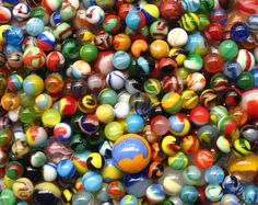 marbles... my favorite childhood toy. and no, not for the game. I built ramps & mazes throughout my entire bedroom! such fun!!