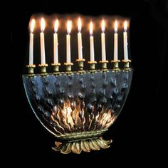 Glowing gold and glass Chanukah menorah