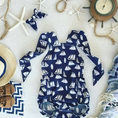 It's the weekend so let's all sail away, unplug and enjoy time with our loved ones 🌊  #nauticalbaby #bandanabib #weekendvibes #flatlay