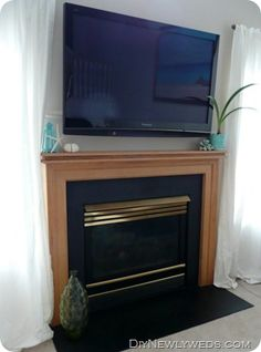 DIY way to hide flat screen TV cables above a fireplace.when we upgrade our downstairs tv and hang it above our fireplace! Home Living Room, Living Room Designs, Living Room Decor, Bedroom Decor, Tv Above Fireplace, Fireplace Refacing, Double Fireplace, Fireplace Mantel, Fireplace Ideas