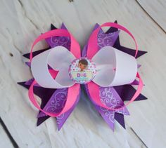 A personal favorite from my Etsy shop https://www.etsy.com/listing/482851537/doc-mcstuffins-hairbow-doc-mcstuffins