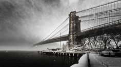 Brooklyn Blizzard - This is a view of the Brooklyn Bridge during Winter Storm Jonas.  Was an amazing amount of snowfall in such a short time.  This  image was taken early in the afternoon and you could barely see halfway across the East River.  This is a three-image panorama taken from Brooklyn Bridge Park, and one of two images taken that day.  The other is an image from up on the bridge and can be viewed <a…