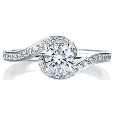 This delecate engagement ring has a modern twist with pave set round diamonds. Matching band MR1577.