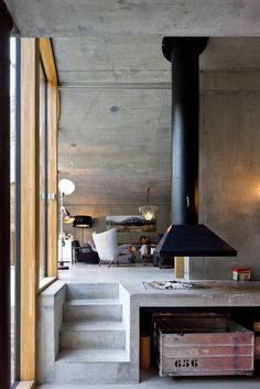 Tagged: Living Room, Hanging Fireplace, Concrete Floor, Chair, Pendant Lighting, and Floor Lighting. Photo 3 of 13 in Stay in a Swiss Vacation Home That's Literally Inside a Mountain