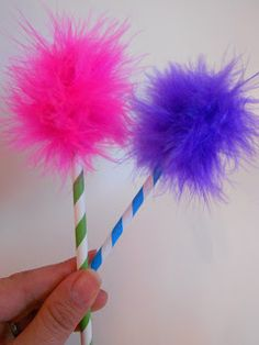 Lorax Truffula Trees--directions use a feather boa cut in pieces and a straw.  Could use a pencil instead.  Great favor.