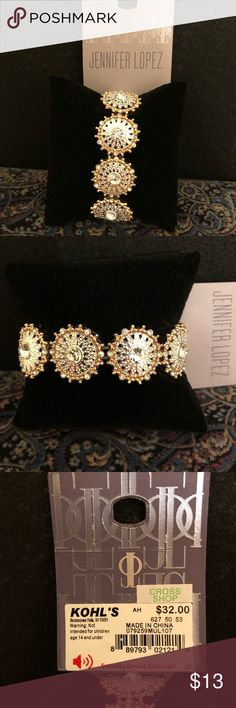 """Gorgeous NWT Jennifer Lopez bracelet!✨✨ Pictures don't show how pretty & sparkling this bracelet is! It is silver tone outlined in rose gold with a round rhinestone in each circle. Diameter is 2.5"""", fits a S-M wrist. Absolutely beautiful!🌟🌟 Jennifer Lopez Jewelry Bracelets"""