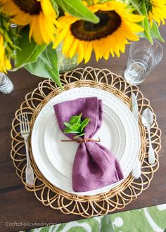 Beautiful Fall Place Setting idea with sunflowers and plum colored napkins #worldmarkettribe #SpruceUpYourSpace