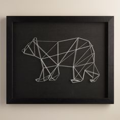 """There are aspects in nature that may seem completely simple, but when you take a closer look, you will discover the array of complex lines and patterns,"" says artist Christine Tong. Her contemporary piece captures this multifaceted aspect of nature with a geometric bear made of white string on a black backdrop."
