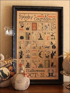 Spooky Countdown       by The Primitive Hare      Fabric : Lakeseide linens  40ct      Thread : DMC
