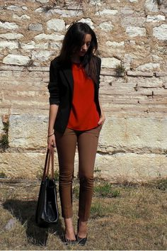 Business casual work outfit: black blazer, red shirt, brown skinnies.