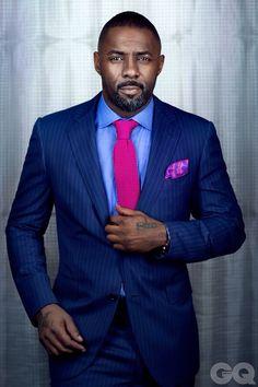 Idris Elba in cobalt and fuchsia
