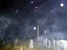 This is a graveyard near by to where I live. Notice all the orbs in the air. It was 26 degrees when this photo was taken so no those are not insects. I've watched orbs act very intelligent in this cemetery. And I see the most orbs ever in this cemetery. I don't know why. It makes one wonder what is really going on here. Why is this particular cemetery a hot bed of paranormal activity. Many people have told of seeing multiple ghosts in this cemetery.