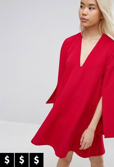 To win the award for chicest person in the whole of your hometown when you go home for Christmas, you'll be needing this baby. Complete with split sleeves and deep V-neck – your investment will give back instantly in Insta double taps
