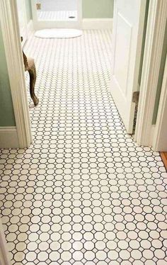 White octagon tile with grey grout for an old fashioned looking bathroom floor