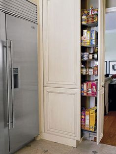 Contain Food Creatively Floor-to-ceiling slide-out pantries offer great stow-away potential. This custom pantry makes the most of a wall return alongside a new refrigerator. The lowest shelves are for kid-friendly foods; wood-mode.com.