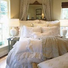 Bed positioned caddy-cornered with mirror and lace curtains provided a shabby chic backdrop