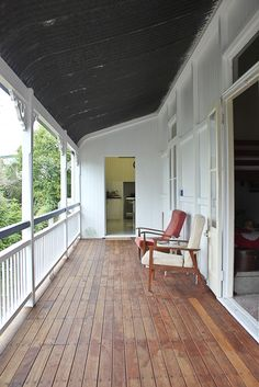 East Ipswich Queenslander | Walk Among The Homes Verandah on old Queenslander house with vintage chairs