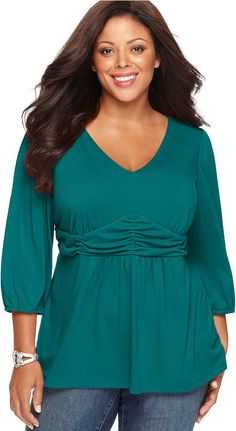 NY Collection Plus Size Three-Quarter-Sleeve Ruched Empire-Waist Top - A feminine silhouette highlights NY Collection's three-quarter sleeve plus size top, accentuated by a ruched empire waist-- snag all the colors!      V-neckline     Three-quarter sleeves with banded cuffs     Banded empire waist with ruching     Babydoll shape