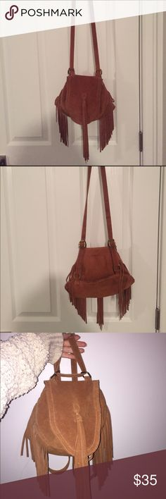 Fringe 2-way convertible backpack/shoulder bag Fringe suede purse that can be worn 2 ways: shoulder bag or backpack! Looks SO cute both ways! In PERFECT condition - used only once or twice!!!!! Great size - actually has a ton of space to hold things (see picture) along with a smaller inside zipper pocket. The closing clip is magnetic Urban Outfitters Bags Shoulder Bags