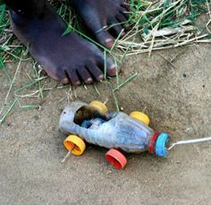 These African kids build their own toys. By comparison, many kids in richer countries are so much more fortunate.