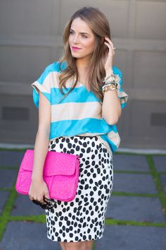 Julia from Gal Meets Glam accessorizes her Dalmatian print skirt with layers of bracelets and a Rebecca Minkoff bag.