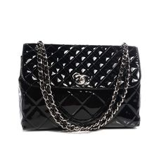 Chanel maxi business vinyl flap bag  a huge bag measuring 13 X 9 X 3 inches  silver hardware on mademoiselle lock and chain  comes with dust-bag and card  asking $2800  comment for more information or to purchase this item