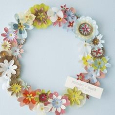 Welcome your wedding guests with this sweet DIY Paper Wreath.