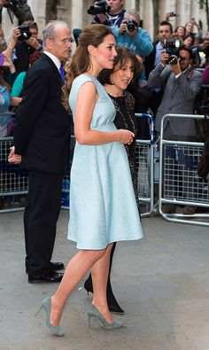 Kate attended an event at the National Portrait Gallery, wearing a '50s-inspired, powder blue Emilia Wickstead dress and grey suede pumps. via StyleList