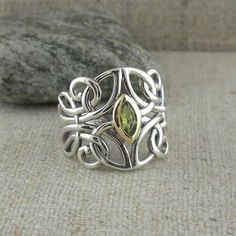 Guardian Angel Ring in Sterling Silver with Gold accent and Sky Blue Topaz, Peridot, Amethyst or CZ. 17 mm tapers to 3 mm Size 5 to 12 Nicely boxed with a silver cloth. Bracelets En Argent Sterling, Silver Bracelets, Silver Earrings, Silver Ring, Diamond Bracelets, Gemstone Earrings, 925 Silver, Gold Rings, Stud Earrings