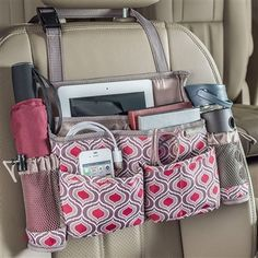 A car front seat organizer with 8 pockets for tablets, smartphones, water bottles, sanitizer and more. Grab the handle and swing it to become a back seat organizer for passenger access. High Road has the best selection of car organizers available. Car Seat Organizer, Car Organizers, Sew Organizer, Purse Organizer Pattern, Diy Sac, Car Office, Car Essentials, Car Storage, Car Hacks
