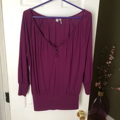 Old navy top. Purple 3/4 sleeve top from Old Navy. It has four buttons to adjust do your liking. Old Navy Tops Blouses