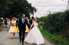 Mustard Yellow Photography | Sarah & Joe's English Church Wedding and Barn Reception   Bride and Groom lead the wedding guests in a procession from the church to their reception